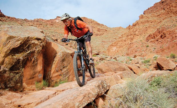 Smoking Something: Trail designer Scott Escott rips up the brand new Pipe Dream singletrack that starts in downtown Moab. Photo: Sharon Hogan
