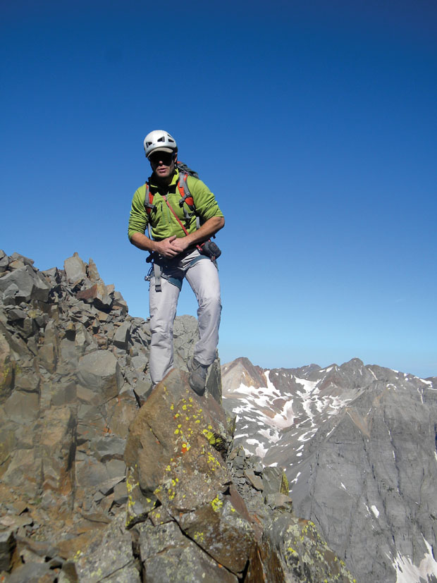 standing tall: late and legendary guide bean bowers takes in the view from atop sneffels.