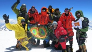 On the top of Cho Oyu. Jim is orange on right, Mike and Matt are in orange in middle.