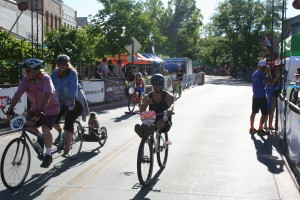 RJ Pursell cruises down Main Street Grand Junction showing just how fun the Clunker Crit can be.