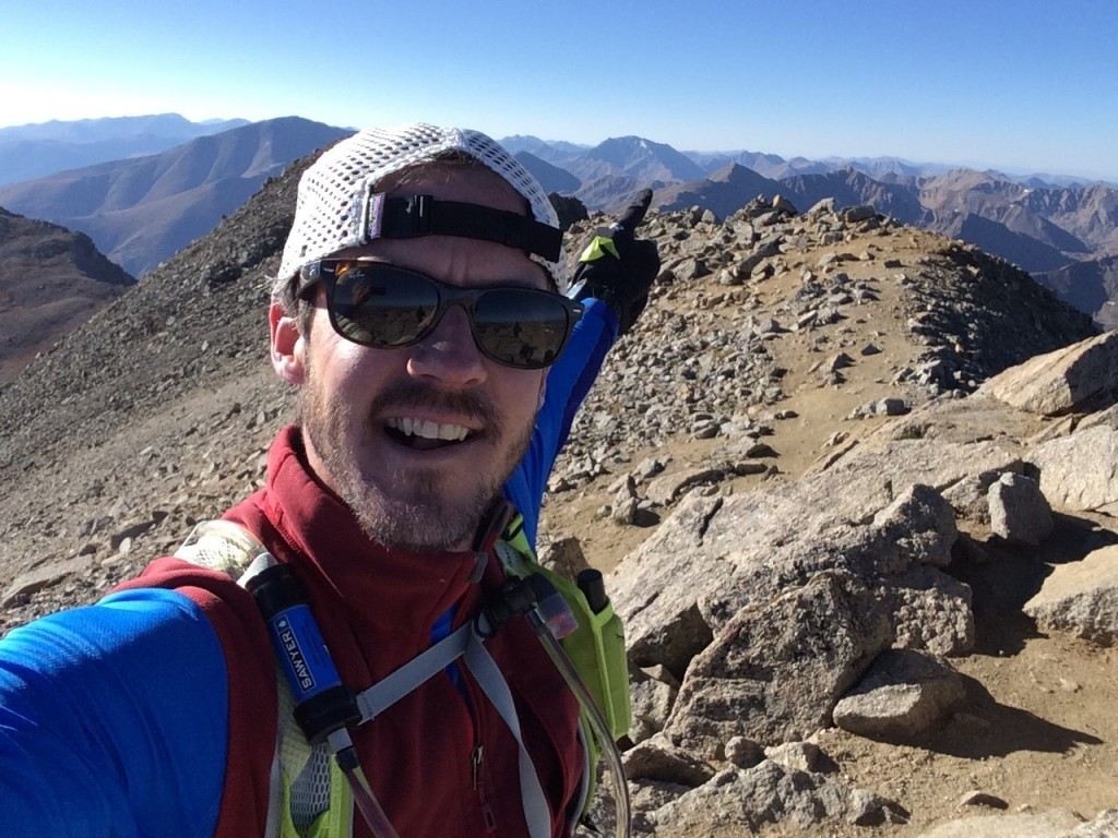 Early on in the journey: Ben points toward La Plata from the summit of Mt. Massive
