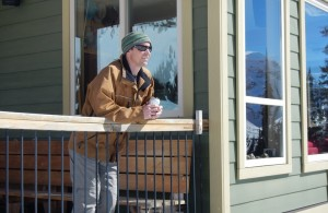 Lodge owner Aaron Cooperman enjoys a beer on the deck