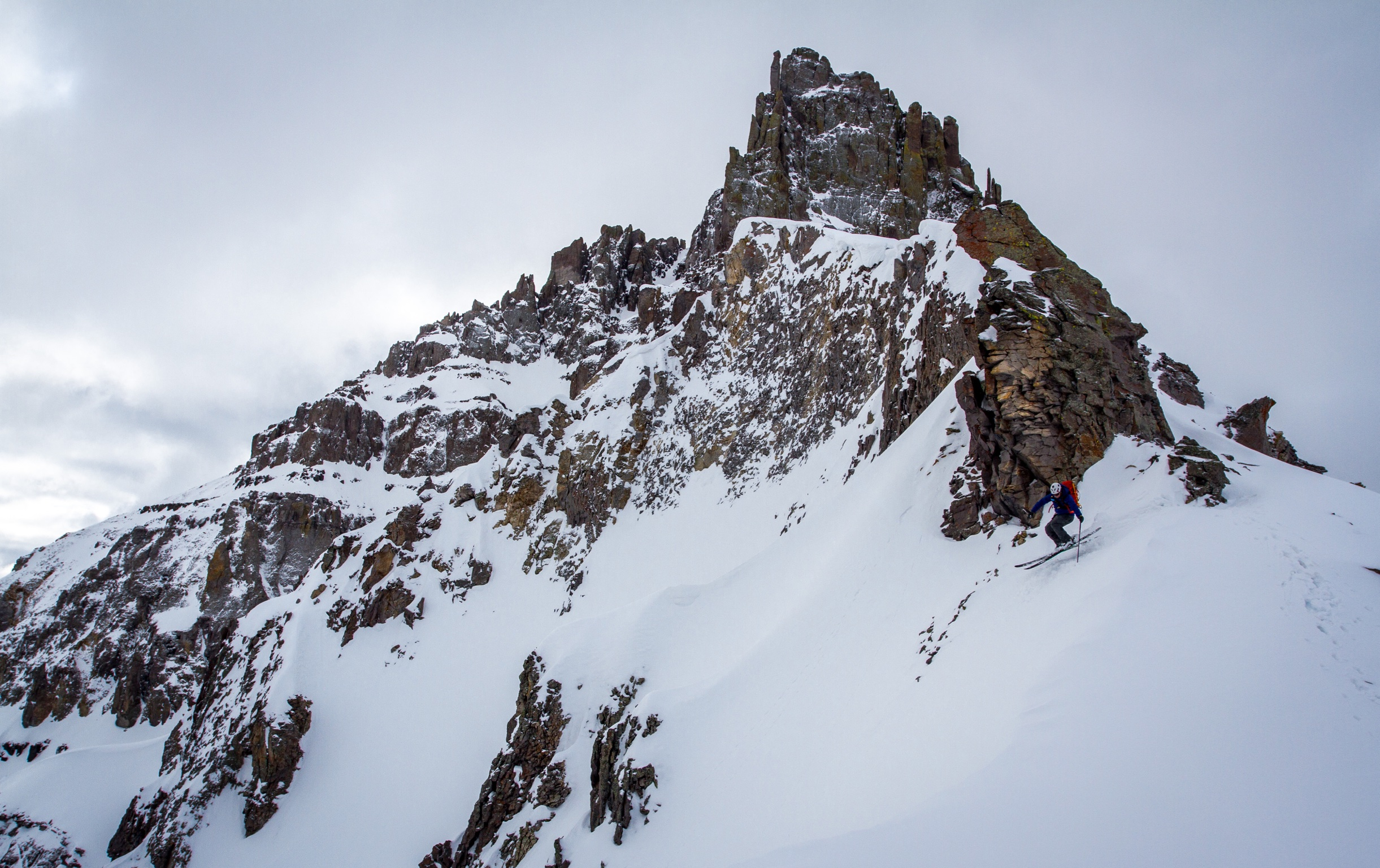 Jon Jay dropping into Weehawken Creek Basin with Potosi Peak looming in the background. Photo: TJ David