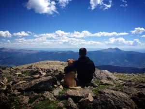 Ryan and Sophie sitting on the summit of Mt. Oxford