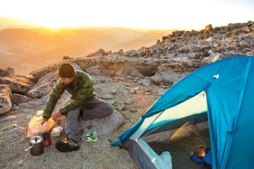 Josh Smith camping on the summit of Mount Mendel, Evolution Traverse, John Muir Wilderness, Kings Canyon National Park, Bishop, California.