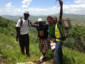 Charles Gerbier, Junior Auguistin, Austin Taylor, and Gavely Gerbier pose for a group shot before descending the mountain in Ran. These guys are all members of the original group that started Expedition Ayiti.