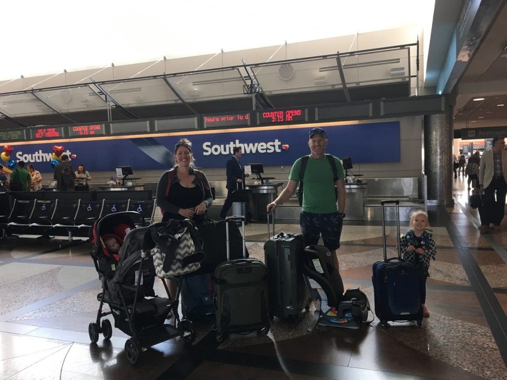 Family with gear at airport
